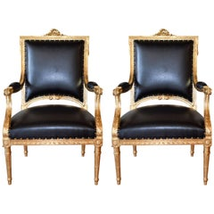 Pair of Louis XVI Style Gilded Armchairs Newly Upholstered in Black Faux Leather
