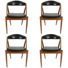 Set of Four Kai Kristiansen Model 31 Teak Dining Chairs with Leatherette