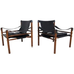 Pair of Sirocco Safari Chair by Arne Norell in Rosewood and Black Leather