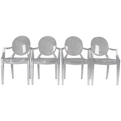 Four Kartell Ghost Chairs