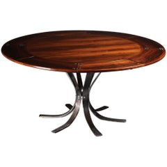 Scandinavian Modern Rosewood Dining Table by Dyrlund of Denmark.