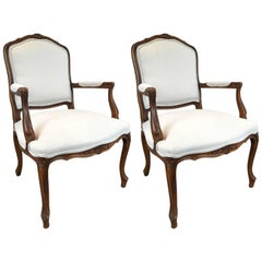 Pair of Carved Walnut Louis XVI Style Armchairs