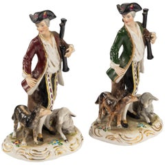 Pair of Early 20th Century Continental Porcelain Figures of Huntsman and Animals