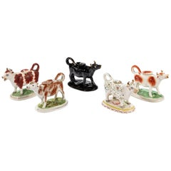 Collection of Five 20th Century Cow Creamers