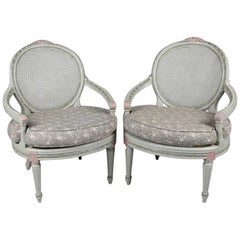 Pair of French Louis XVI Style Paint Decorated Caned & Upholstered Armchairs