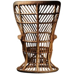 Wicker chair designed by Lio Carminati