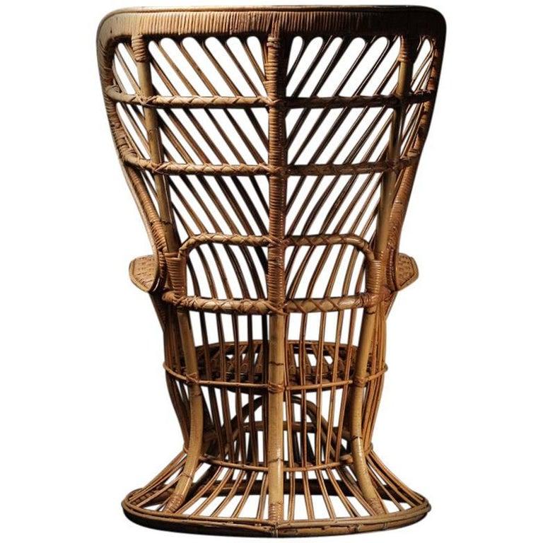 Wicker chair designed by Lio Carminati For Sale