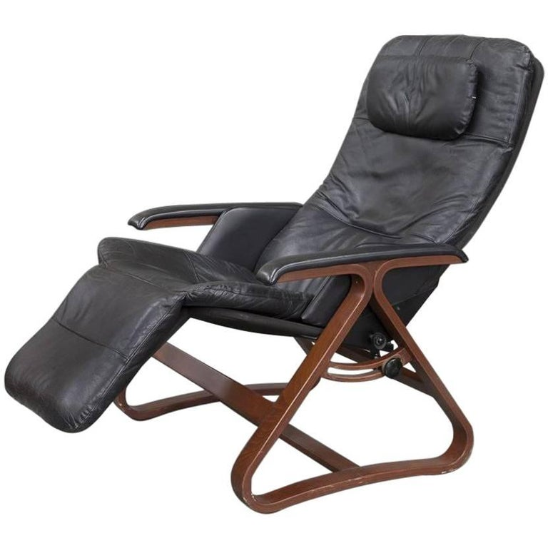 Contemporary Black Leather And Wood Reclining Armchair