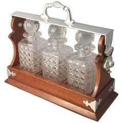 English Tantalus or Decanter Set for Spirits of Oak and Silver
