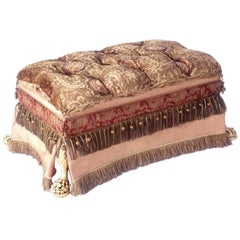 Footed Ottoman, Upholstered in Various Fabrics with Antique Fringe and Trim