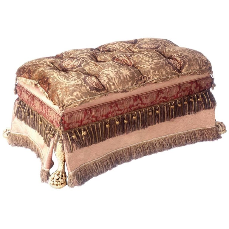 Footed Ottoman, Upholstered in Various Fabrics with Antique Fringe and Trim For Sale