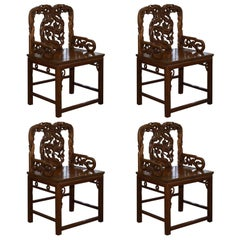 Rare Set of Four Antique Zitan Passion Flower Carved Chinese Imperial Chairs