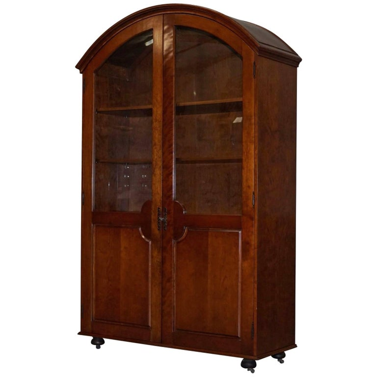 Solid Mahogany Bow Topped Bookcase with Glass Door For Sale