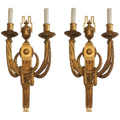 Pair of French Regency Neoclassical Wreath Draped Urn Two-Arm Bronze Sconces