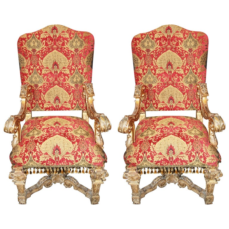 Pair of Louis XIV Carved and Gilded Chairs For Sale