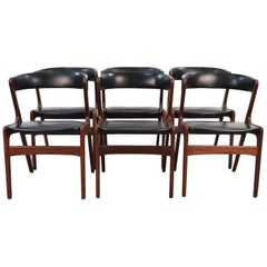 Set of Six Danish Midcentury Teak and Black Skai Seat Side Chairs by Omann Jr.