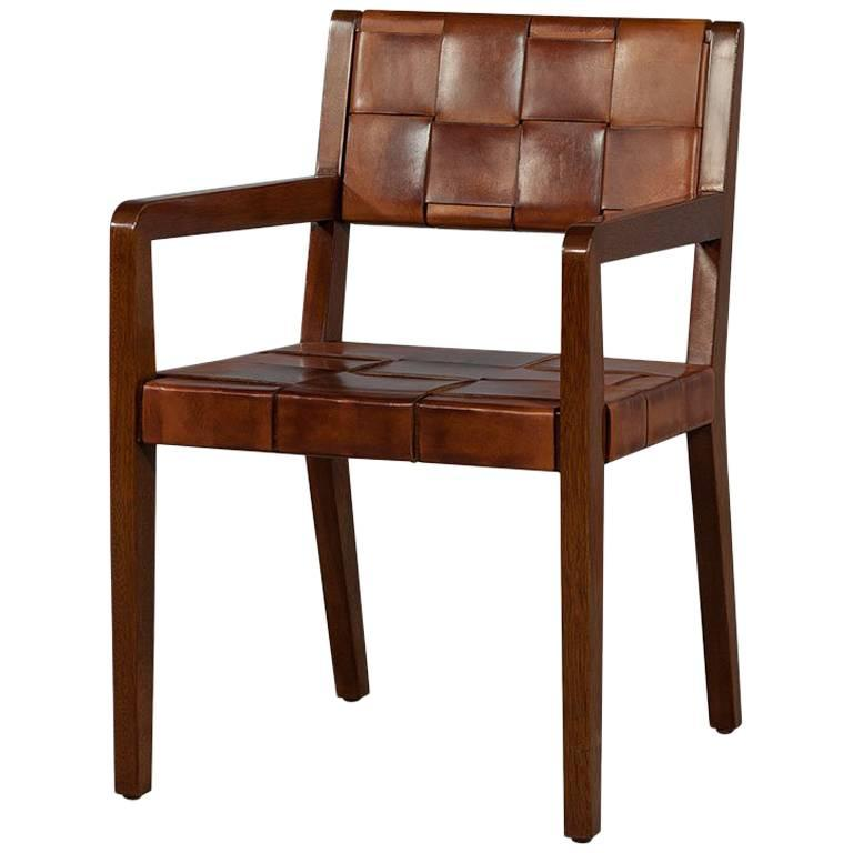 Safari woven leather arm desk chair for sale at stdibs