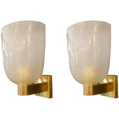 Pair of Italian Ivory and Gold Flecked Murano Glass and Brass Sconces