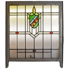Stained Glass Window with Red and Green Shield