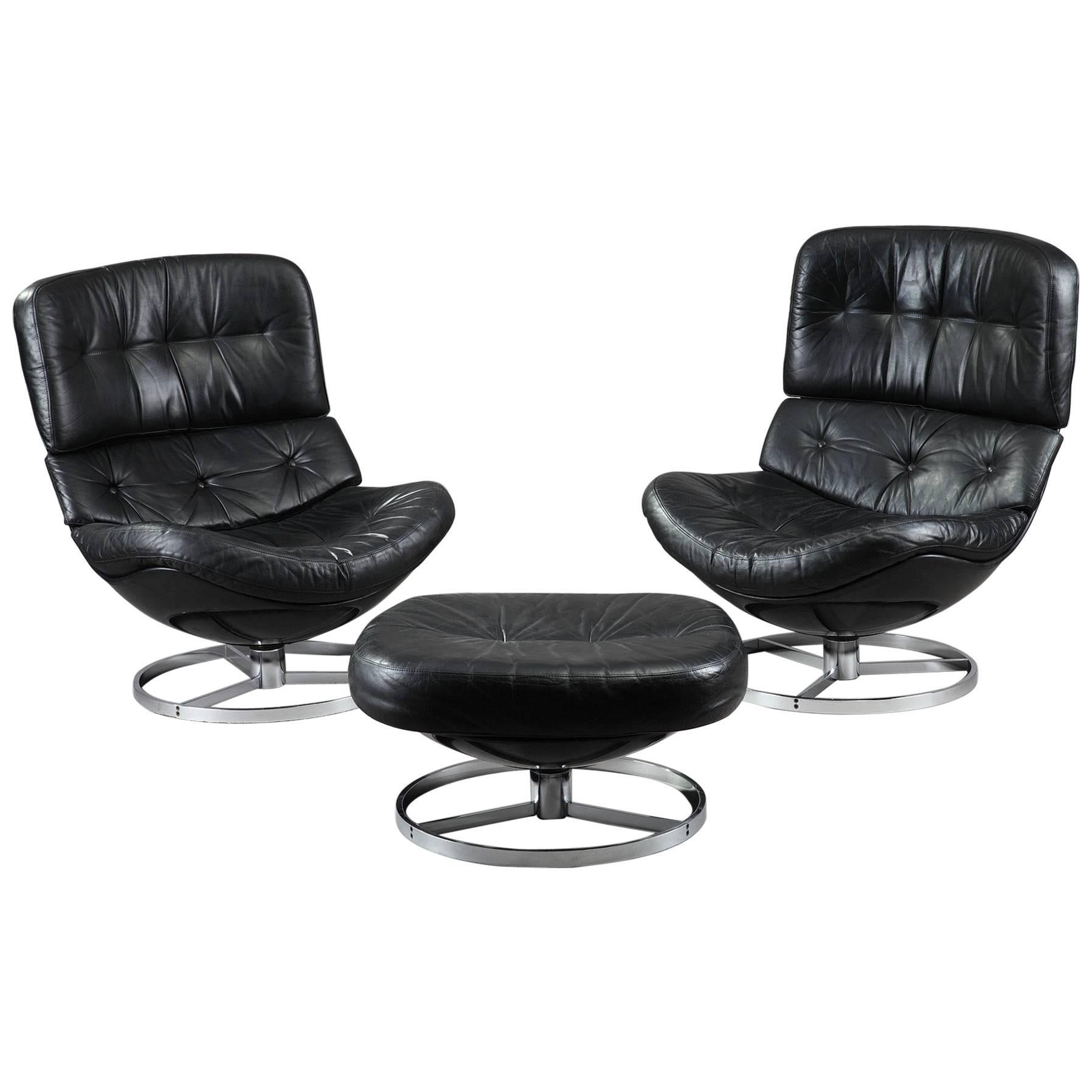 Pair Of Swivel Armchairs And Ottoman In Fiberglass And Leather