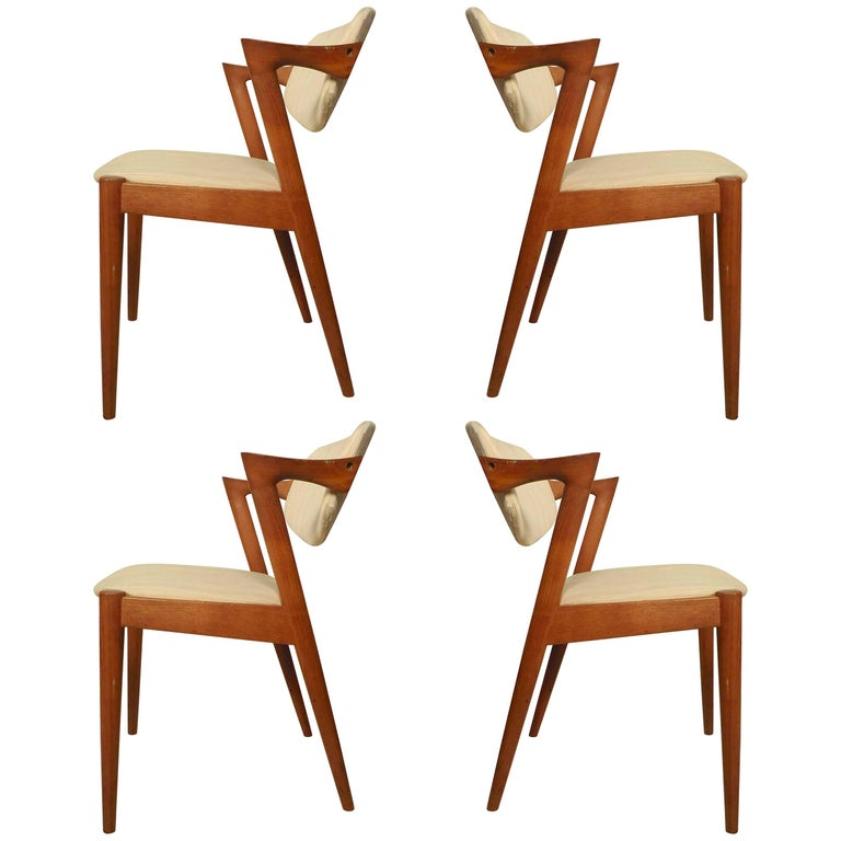 Mid Century Danish Model 75 Teak Dining Chairs By Niels Moller For