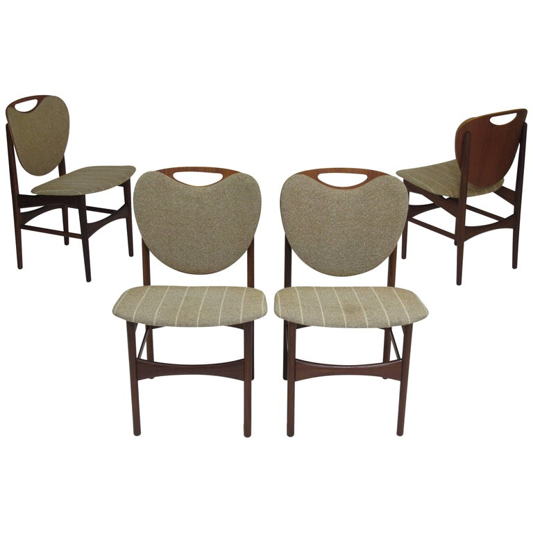 Four Shield Back Teak Dining Chairs