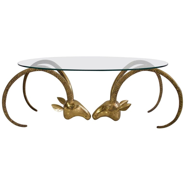 Brass Ibex Coffee Table with Glass Top in the Style of Alain Chervet