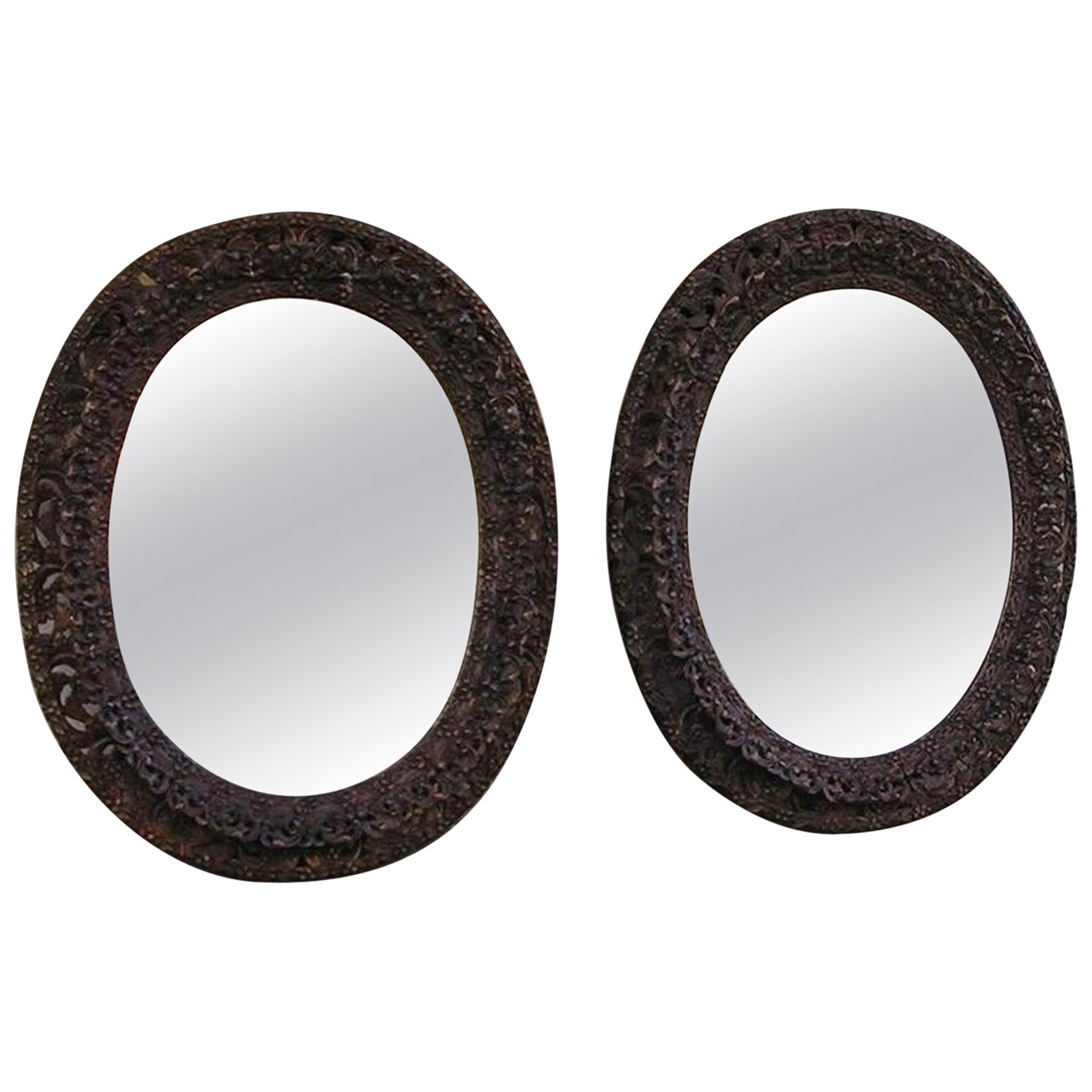 Pair of Anglo-Indian Mahogany Floral Carved Oval Mirrors, Circa 1810