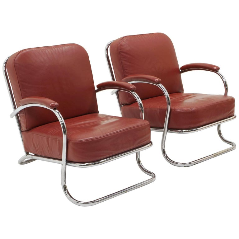 Pair of Tubular Chrome and Red Leather Lounge Chairs by KEM Weber for Lloyd
