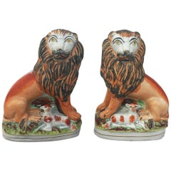 Pair of 19th Century English Staffordshire Lions with Lambs
