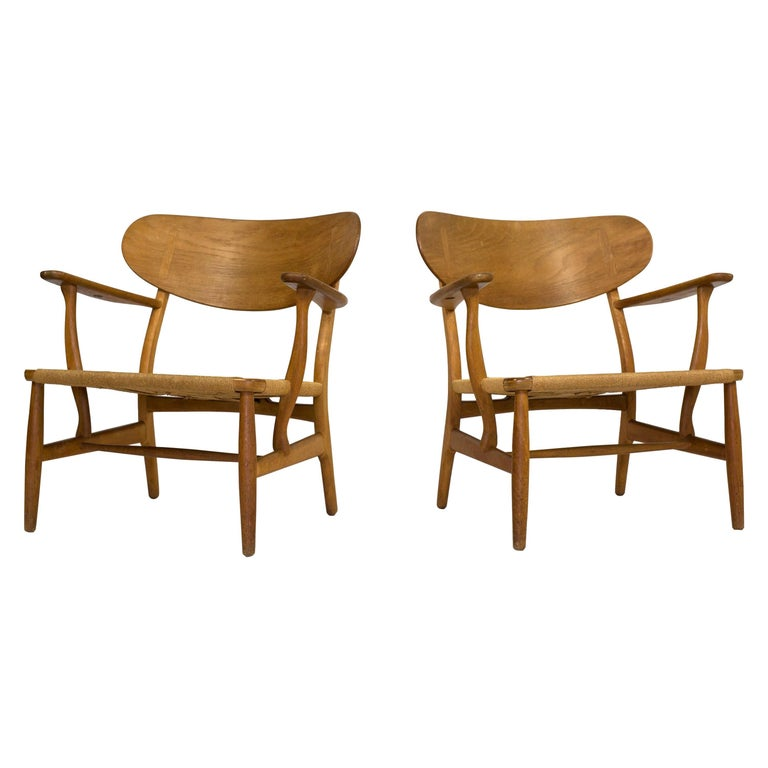 Hans J. Wegner, a Pair of CH22 Lounge Chairs