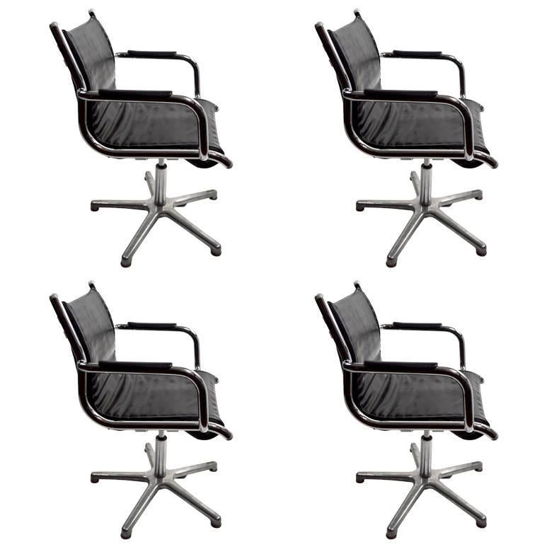 Four Chrome and Black Swivel Chairs by Olymp