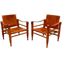 Pair of Danish Modern Wood and Leather Safari Chairs in the Style of Kaare Klint