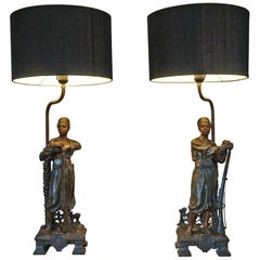 Striking Early 1900s Pair of Blackamoor Table Lamps with Guards Holding Rifles