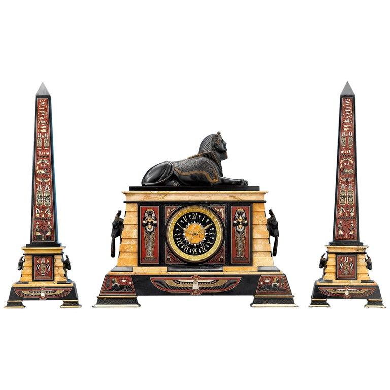 Egyptian Revival Clock Garniture For Sale