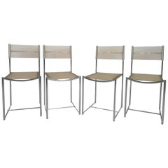 Amazing Set of Four Chrome and Vinyl Cord Dining Chairs