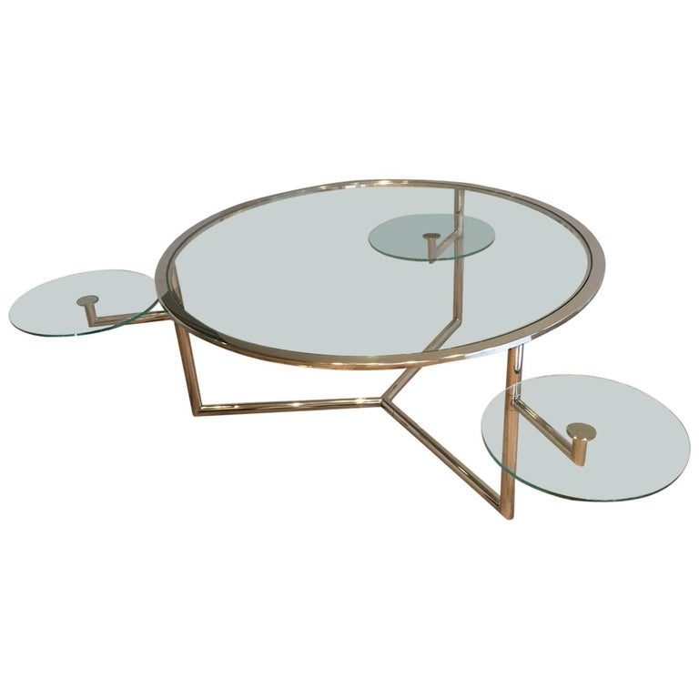 Round chrome coffee table with three pivoting glass for Round glass coffee tables for sale