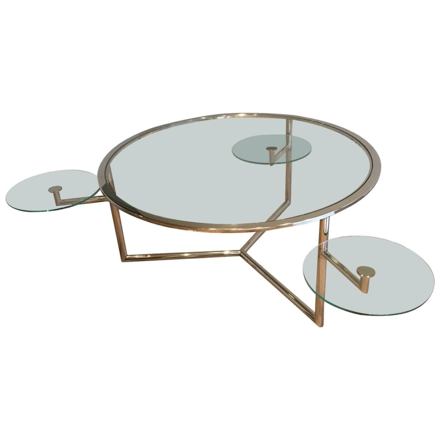 Round Chrome Coffee Table With Three Pivoting Glass Shelves 1