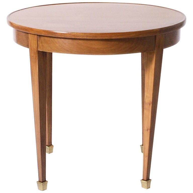 small round merisier cigarette table with brass sabots, circa 1940