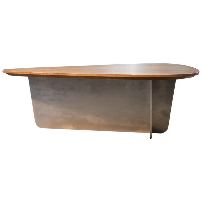 Contemporary coffee table by P. Cramer with metal leg and wooden oak table top