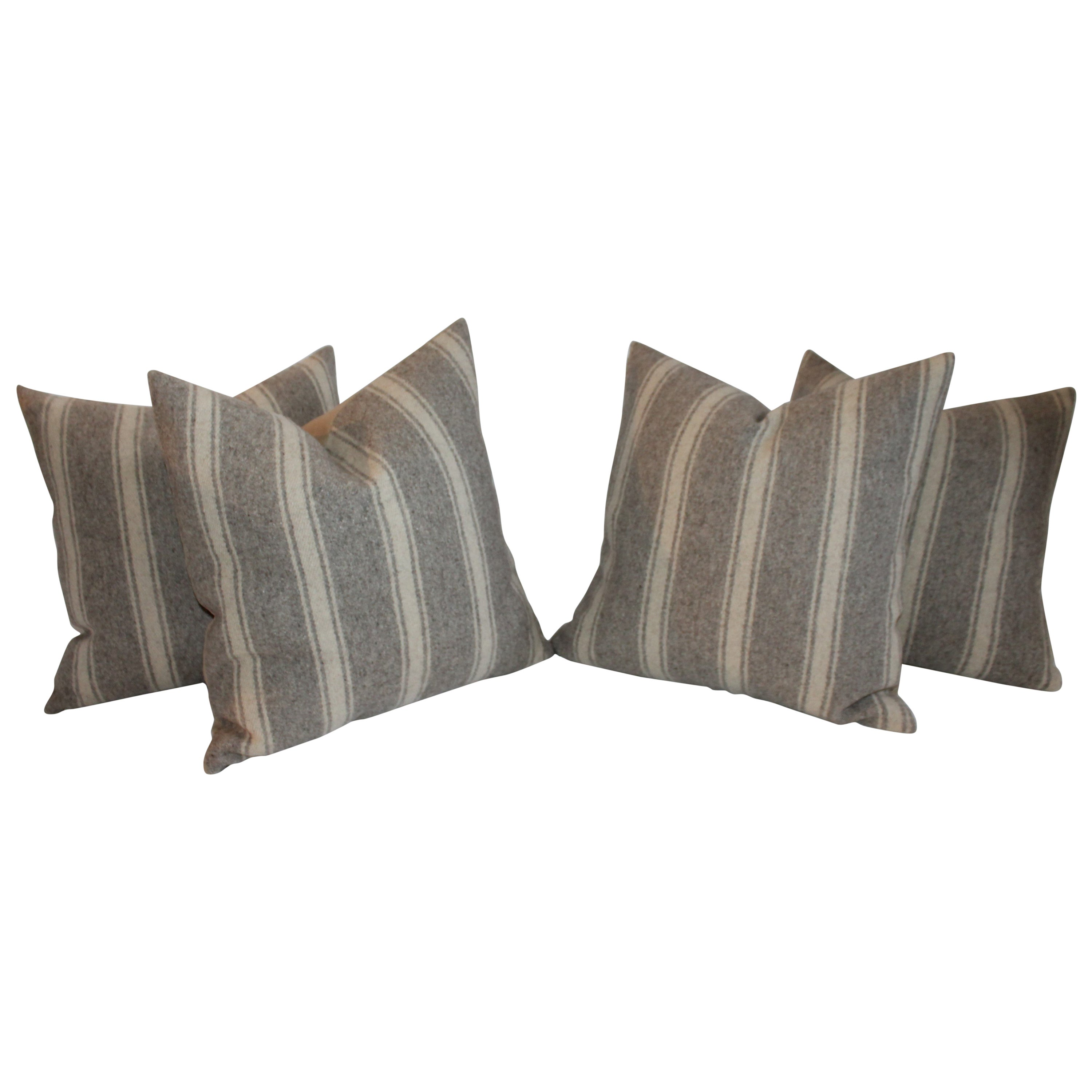 Collection of Four Saddle Blanket Weaving Pillows