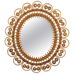 Spit Curl Oval Shaped Rattan Wall Sunburst Mirror, France, 1950s