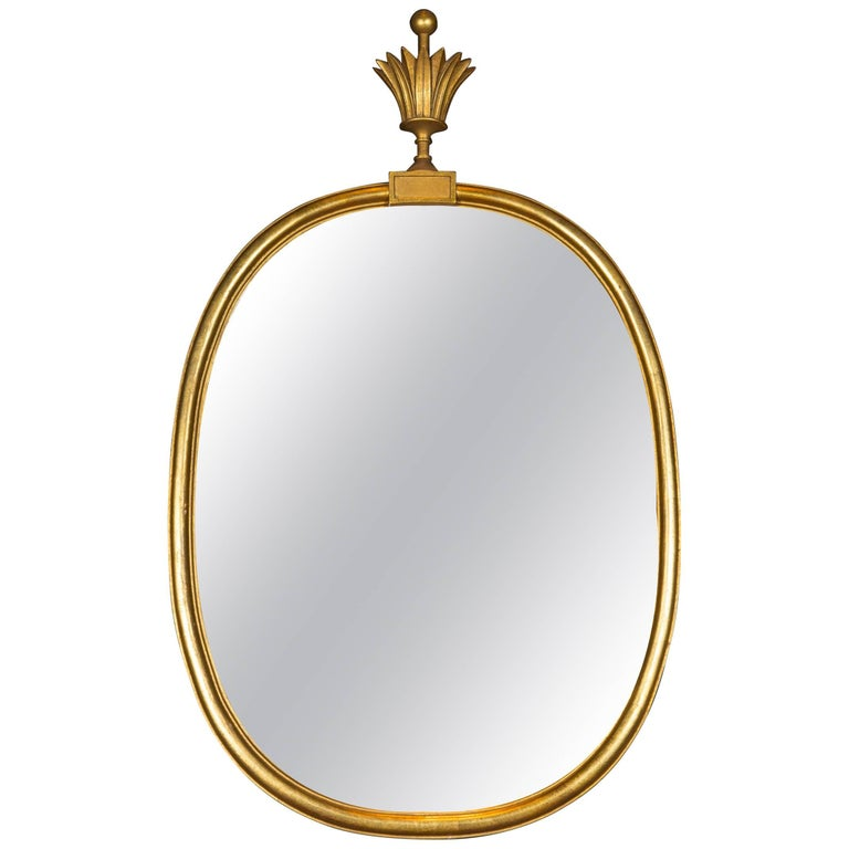 Tommi Parzinger Oval Gilt Mirror with Crown For Sale