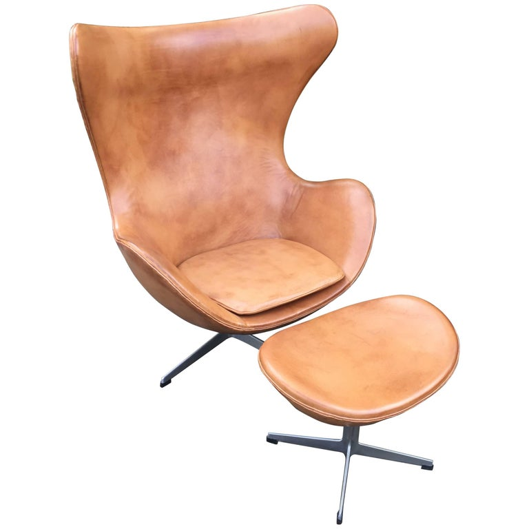 Cognac Leather Egg Chair and Footstool by Arne Jacobsen for Fritz Hansen
