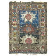 Distressed Antique Caucasian Rug