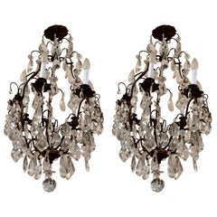 Matching Pair of Glitzy French Gilt Metal and Cut Glass Chandeliers