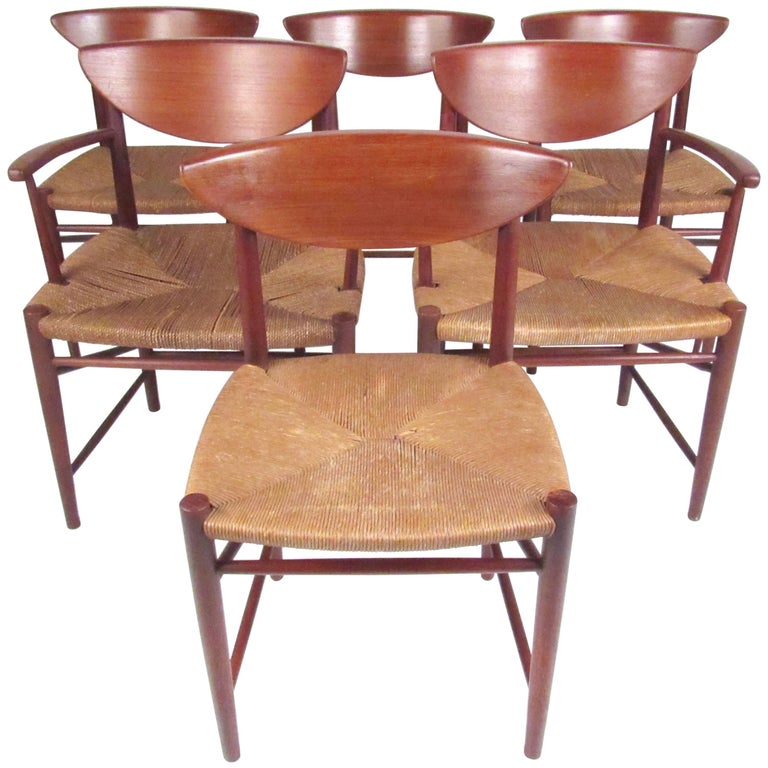 Set of Six Peter Hvidt Dining Chairs in Teak and Rush For Sale
