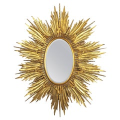 Large 1940s Carved Giltwood Hollywood Regency Sunburst or Starburst Oval Mirror