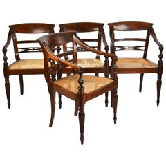 Set of Four British Colonial Hardwood Open Armchairs