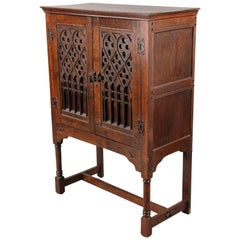 Turn of the Century Spanish Revival Cabinet with Carved Front with Iron Hardware